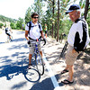 From left to right Pablo and German Velasco discuss the spot they've picked on Flagstaff Mountain to view the finishing climb of the Pro Cycling Challenge in Boulder.<br /> Photo by Paul Aiken