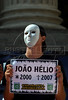 A demonstrator of the 'Rio de Paz' (Rio of Peace) NGO protests in Rio's dowtown against the unsolved crimes in the city, placing on the ground one pebble for each crime, Rio de Janeiro, Brazil, May 11, 2009. Rio de Paz NGO placed 17,000 stones on the ground to represent the victims of violence killed during the past 28 months in the state of Rio, organizers said. (Austral Foto/Renzo Gostoli)