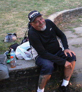 DAVID KNOX / GAZETTE John Penley, 64, of New York City, relaxes at Cleveland's Kirtland Park campsite on the city's east side, just south of the Shoreway. Penley's requests for camping space for anti-Trump protesters were rejected, but Cleveland officials agreed last week Kirtland Park would be open for overnight camping to everyone.