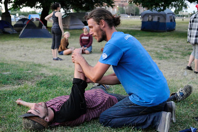 Anti-Trump protestors practice first aid techniques during a training session Tuesday night at the Kirtland Park campsite. DAVID KNOX / GAZETTE
