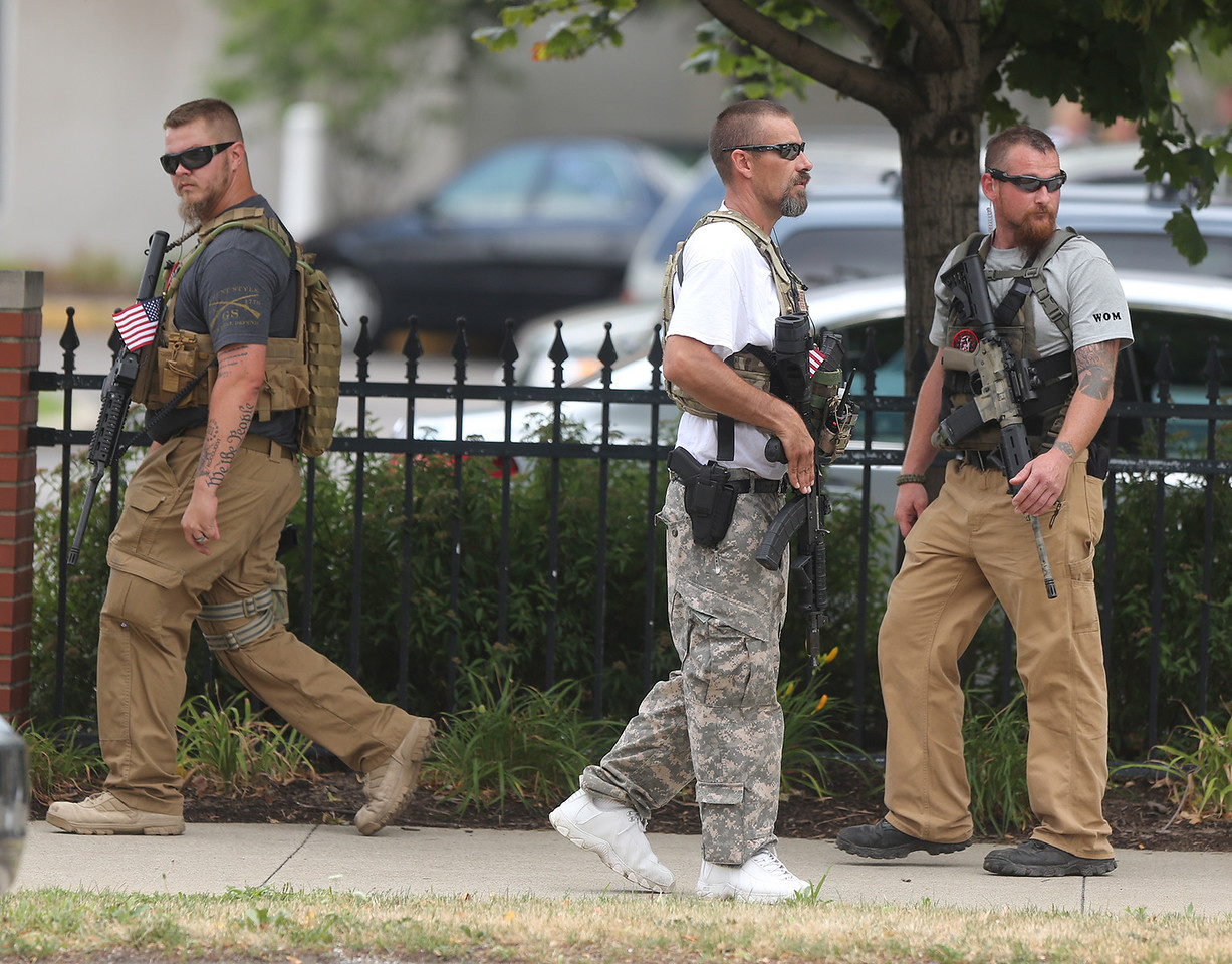 Men armed with semi-automatic rifles marched down W25th street in Cleveland exercising their rights to march and carry. BRUCE BISHOP/GAZETTE