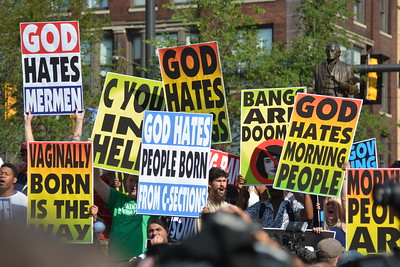 BILL KEATON/GAZETTE A group calling themselves the Eastboro Baptist Church protest in downtown Cleveland.