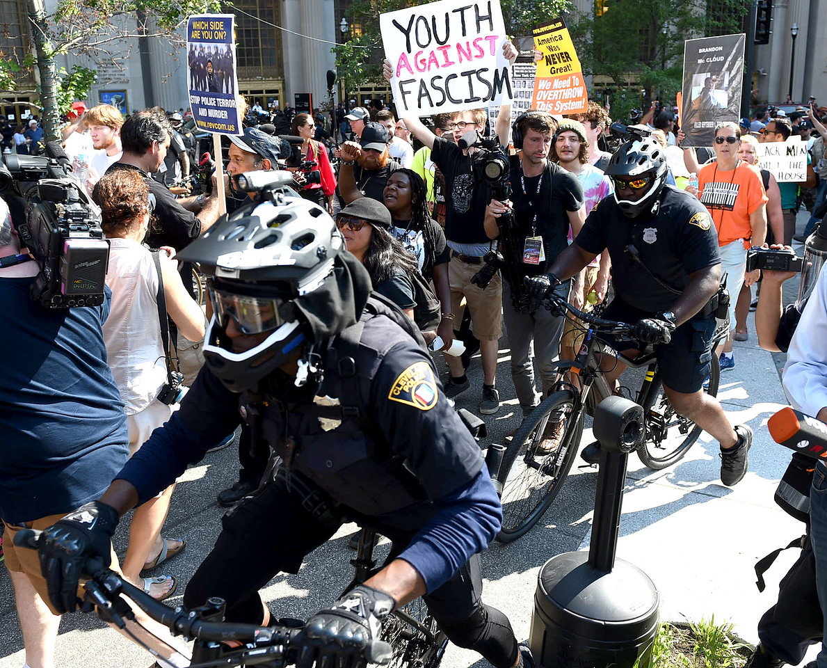 KRISTIN BAUER | GAZETTE Protesters marched through public square and then down Euclid Ave. as police officers surrounded them, guarding them from traffic and passersby.