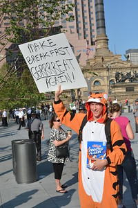 BILL KEATON/GAZETTE Some protesters were a little more serious than others Tuesday on Public Square in Cleveland.