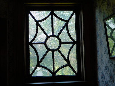 BOB FINNAN / GAZETTE One of the windows off the sitting room has a spider-web design.