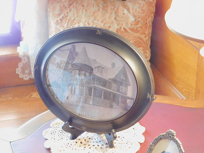 BOB FINNAN / GAZETTE A framed picture of the McDowell-Phillips House sits on one of the tables.