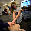KRISTOPHER RADDER - BRATTLEBORO REFORMER<br /> With help from an instructor, Meaghan Landing, an eighth-grader at Putney Central School, practices chest compressions on a dummy during a Safety Day event at Putney Central School on Thursday, April 26, 2018.