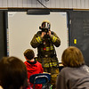 KRISTOPHER RADDER - BRATTLEBORO REFORMER<br /> Putney Firefighter Lenny Howard shows a fourth-grade class how he puts on his gear during a Safety Day event at Putney Central School on Thursday, April 26, 2018.