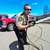 "KRISTOPHER RADDER - BRATTLEBORO REFORMER<br /> Windham County Sheiff's Deputy First Class Ian ""Cuttle"" Tuttle mans a hose during a Safety Day event at Putney Central School on Thursday, April 26, 2018."