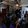 KRISTOPHER RADDER - BRATTLEBORO REFORMER<br /> Jason Antos, an EMT at Rescue Inc., talks to a group of fourth-graders at Putney Central School inside an ambulance during a Safety Day event at Putney Central School on Thursday, April 26, 2018.