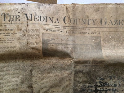 ANNIE RYAN HYRA / SPECIAL TO THE GAZETTE A Gazette newspaper from Oct. 2, 1914, was found Saturday in a time capsule opened by the Medina County Historical Society.