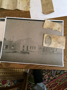 ANNIE RYAN HYRA / SPECIAL TO THE GAZETTE A time capsule from 1914 found at the site of the demolished Pythian Sisters home on Huntington Street in Medina contained a photo of the home's construction and a business card.