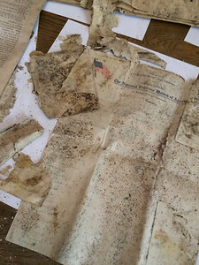 ANNIE RYAN HYRA / SPECIAL TO THE GAZETTE A document from the National Veterans' Women of America group was found in a time capsule Saturday by the Medina County Historical Society.