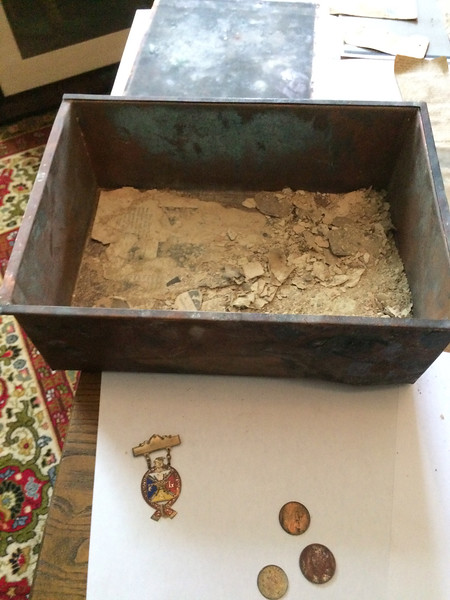 ANNIE RYAN HYRA / SPECIAL TO THE GAZETTE Shown are some of the contents of a time capsule found at the demolished Pythian Sisters home on Huntington Street in Medina. The capsule was opened Saturday by officials from the Medina County Historical Society.