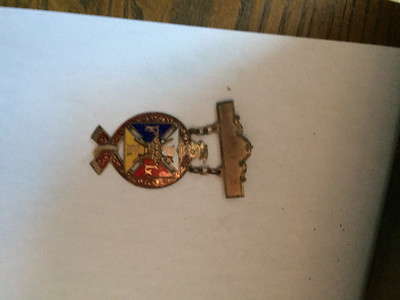 ANNIE RYAN HYRA / SPECIAL TO THE GAZETTE A Pythian Sister pendant was found inside a time capsule opened Saturday by the Medina County Historical Society.