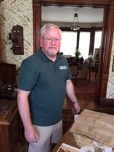 ANNIE RYAN HYRA / SPECIAL TO THE GAZETTE Medina County Historical Society president Brian Feron is shown with contents of a time capsule from 1914 that was opened Saturday.