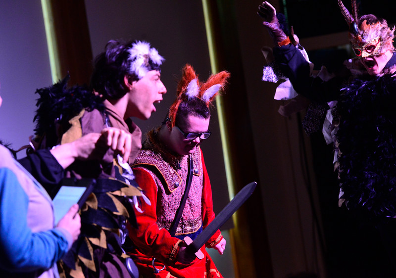 """KRISTOPHER RADDER - BRATTLEBORO REFORMER<br /> Elijah Jenson and Noah Raymond as Turkator surround Brian White as Ronado during a dress rehearsal of """"Questery"""" on Monday, May 14, 2018."""