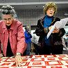 """Bonnie Swanson, left, points out a name on a quilt that Jane Haeker reads off of from her information sheet at First Lutheran Church in Longmont on Monday Feb. 11, 2013. The quilt was made in 1895, and was recently found in the church's vault. DAILY CAMERA/ JESSICA CUNEO. For more photos and a video, go to <a href=""""http://www.timescall.com/"""">http://www.timescall.com/</a>."""