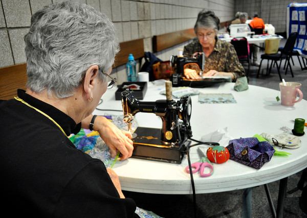 "Linda Kepler, left, and Linda Parmentier work on quilts for next year's Quilt Sale at First Lutheran Church in Longmont on Monday Feb. 11, 2013. DAILY CAMERA/ JESSICA CUNEO. For more photos and a video, go to <a href=""http://www.timescall.com/"">http://www.timescall.com/</a>."