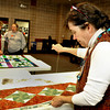 "Edie Bell, right, works on a table runner for next year's Quilt Sale at First Lutheran Church in Longmont on Monday Feb. 11, 2013. DAILY CAMERA/ JESSICA CUNEO.  For more photos and a video, go to <a href=""http://www.timescall.com/"">http://www.timescall.com/</a>."