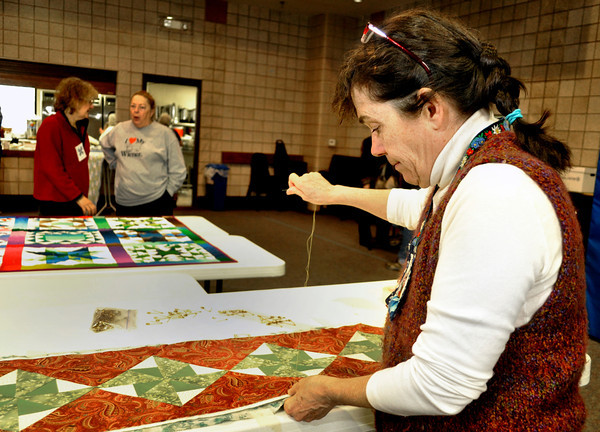 """Edie Bell, right, works on a table runner for next year's Quilt Sale at First Lutheran Church in Longmont on Monday Feb. 11, 2013. DAILY CAMERA/ JESSICA CUNEO.  For more photos and a video, go to <a href=""""http://www.timescall.com/"""">http://www.timescall.com/</a>."""