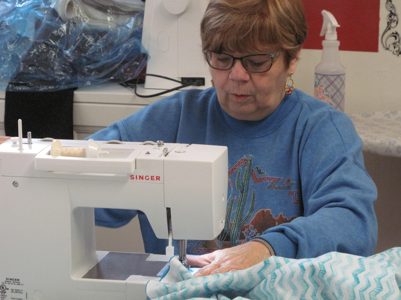 ELIZABETH DOBBINS / GAZETTE Kris May of Brunswick concentrates as she sews her latest project.