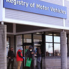 Registry of Motor Vehicles security officers from Internal Security Association keep social distancing in effect in the line outside the Lawrence RMV, one of eight RMV offices open, and only by appointment. People were let in as they were able to be served. (SUN/Julia Malakie)