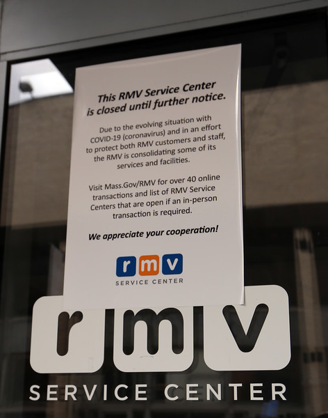 Sign at the Registry of Motor Vehicles office on Middlesex Street in Lowell, closed in the RMV's effort to minimize visits to customer centers and do more online, with eight offices open by appointment only. (SUN/Julia Malakie)
