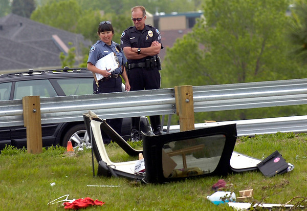 Investigators at the scene of a rollover accident at the onramp to Foothills Parkway in Boulder on Thursday morning. Photo by Paul Aiken