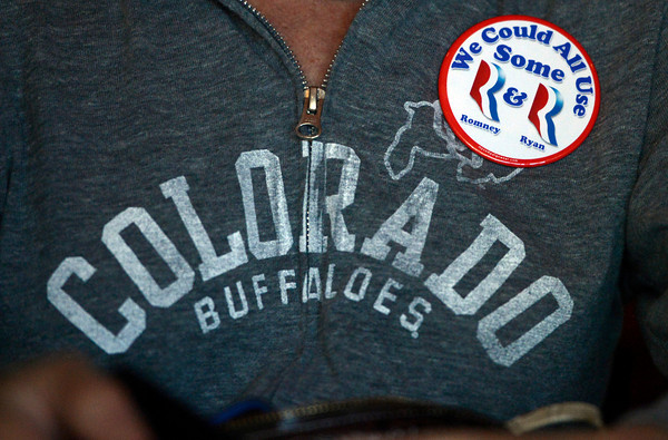 "A Mitt Romney campaign pin is pinned on a supporters University of Colorado sweatshirt during a Mitt Romney campaign stop on Thursday, Sept. 13, at Geisty's Dogg House in Boulder. For a video of the Romney campaign stop go to  <a href=""http://www.dailycamera.com"">http://www.dailycamera.com</a><br /> Jeremy Papasso/ Camera"