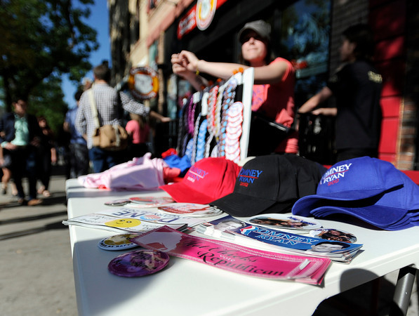 """Mitt Romney campaign gear sits on a table outside of Geisty's Dogg House in Boulder on Thursday, Sept. 13, during a Mitt Romney campaign stop on Thursday, Sept. 13, in Boulder. Romney's son Josh Romney gave a speech at the campaign stop. For a video of the Romney campaign stop go to  <a href=""""http://www.dailycamera.com"""">http://www.dailycamera.com</a><br /> Jeremy Papasso/ Camera"""