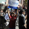 "Gail Russo, of Longmont, at front, shows her support as Josh Romney steps off the campaign bus during a Mitt Romney campaign stop on Thursday, Sept. 13, at Geisty's Dogg House in Boulder. For a video of the Romney campaign stop go to  <a href=""http://www.dailycamera.com"">http://www.dailycamera.com</a><br /> Jeremy Papasso/ Camera"