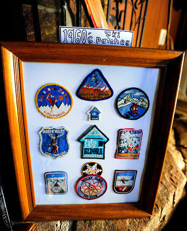 Jackson013x.jpg at Jackson's house in Boulder on Tuesday Feb. 19, 2013. DAILY CAMERA/ JESSICA CUNEO. <br /> Ross Jackson, who has been a part of the Flatirons Ski Club for 49 years, displays his memorabilia including lift tickets and patches from the 1960's at his house in Boulder on Tuesday, Feb. 19, 2012. DAILY CAMERA/ JESSICA CUNEO.