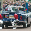 Britain's Prince William drives his wife Kate, Duchess of Cambridge, away from Buckingham Palace in a vintage Aston Martin Volante convertible after their wedding at London's Westminster Abbey, Friday, April, 29, 2011. (AP Photo/Bogdan Maran)