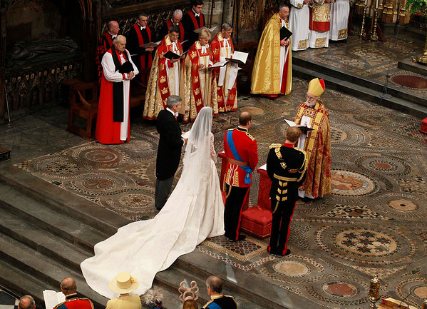 The Archbishop of Canterbury Rowan Williams, marries Britain's Prince William , 2nd right, and Kate Middleton, 2nd left, as Michael Middleton, Kate Middleton's father, left, and best man Britain's Prince Harry, right, look on during the wedding service at Westminster Abbey at the Royal Wedding in London Friday, April, 29, 2011. (AP Photo/Kirsty Wigglesworth, pool)
