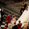 Britain's Prince William bows and his wife Kate, Duchess of Cambridge, curtsies in front of Britain's Queen Elizabeth II  as they leave Westminster Abbey accompanied by his best man Britain's Prince Harry  and her maid of honour Pippa Middleton  after the wedding service at the Royal Wedding in London Friday, April, 29, 2011. (AP Photo/Kirsty Wigglesworth, pool)