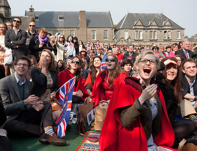 Students gather to watch the wedding of Britain's Prince William and Kate Middleton on a large screen in the grounds of St Andrews University, St Andrews, Scotland, Friday, April 29, 2011. (AP Photo/Chris Clark)