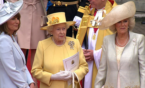 In this image taken from video, from left, Carole Middleton, Kate Middleton's mother, Britain's Queen Elizabeth II and Camilla, Duchess of Cornwall stand outside Westminster Abbey for the Royal Wedding in London on Friday, April, 29, 2011. (AP Photo/APTN) EDITORIAL USE ONLY NO ARCHIVE PHOTO TO BE USED SOLELY TO ILLUSTRATE NEWS REPORTING OR COMMENTARY ON THE FACTS OR EVENTS DEPICTED IN THIS IMAGE