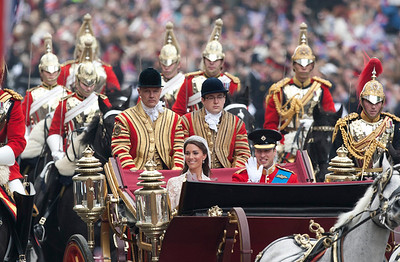 Britain's Prince William and his wife Kate, the Duchess of Cambridge, approach the Cenotaph as they make their way towards Buckingham Palace after their wedding in London's Westminster Abbey, Friday, April, 29, 2011. (AP Photo/Jon Super)