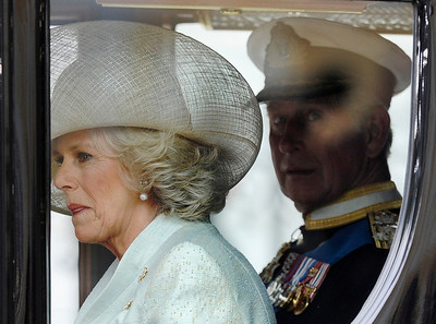 Camilla, Duchess of Cornwall, left, and Britain's Prince Charles  leave Westminster Abbey after the wedding service at the Royal Wedding in London Friday, April, 29, 2011. (AP Photo/Martin Meissner)