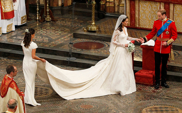 Britain's Prince William and his wife Kate, Duchess of Cambridge, accompanied by her maid of honour Pippa Middleton leave after wedding service in Westminster Abbey at the Royal Wedding in London Friday, April, 29, 2011. (AP Photo/Kirsty Wigglesworth, pool)