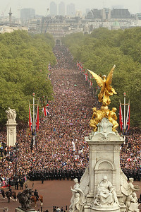 Members of the public proceed along the Mall and around the Queen Victoria Memorial as they celebrate the wedding of Britain's Prince William and his wife Kate, Duchess of Cambridge, London, Friday, April 29, 2011. (AP Photo/Oli Scarff, Pool)