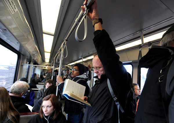 "University of Colorado at Denver professor Steve Beckman reads a book while riding the Light Rail home after work in Denver on Thursday, March 1. For more photos and video of the construction go to  <a href=""http://www.dailycamera.com"">http://www.dailycamera.com</a><br /> Jeremy Papasso/ Camera"