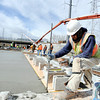 "Mesa Construction's Alberto Valenzuela tests the concrete while working on RTD's West Line Lightrail track at 13th and Federal in Denver on Thursday, March 1. For more photos and video of the construction go to  <a href=""http://www.dailycamera.com"">http://www.dailycamera.com</a><br /> Jeremy Papasso/ Camera"