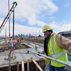 "Mesa Construction's Robert Torres floats some concrete while working on RTD's West Line Lightrail track at 13th and Federal in Denver on Thursday, March 1. For more photos and video of the construction go to  <a href=""http://www.dailycamera.com"">http://www.dailycamera.com</a><br /> Jeremy Papasso/ Camera"