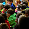 KRISTOPHER RADDER - BRATTLEBORO REFORMER<br /> Students cover their ears as Steve Klimowski, a clarinet player in the Vermont Symphony Orchestra's woodwind trio, Raising Cane!, plays some of the highest notes that a clarinet can reach during a performance at Saxtons River Elementary on Monday, May 14, 2018.
