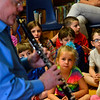 "KRISTOPHER RADDER - BRATTLEBORO REFORMER<br />  A group of students watches Steve Klimowski, a clarinet player in the Vermont Symphony Orchestra's w woodwind trio, Raising Cane!, plays a song from the Disney movie, ""Pocahontas,"" during a performance at Saxtons River Elementary on Monday, May 14, 2018."