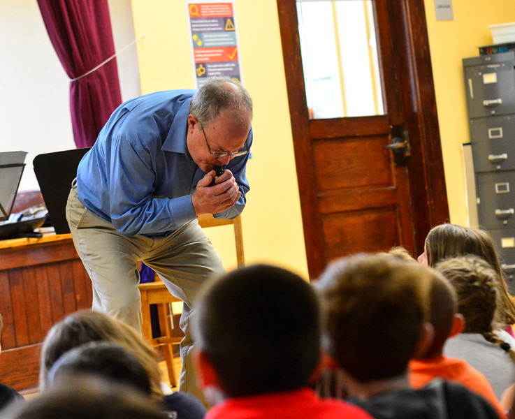 "KRISTOPHER RADDER - BRATTLEBORO REFORMER<br /> Steve Klimowski, a clarinet player in the Vermont Symphony Orchestra's woodwind trio, Raising Cane!, tries to play ""Yankee Doodle"" by just using the mouthpiece of the clarinet during a performance at Saxtons River Elementary on Monday, May 14, 2018."