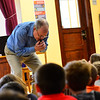 """KRISTOPHER RADDER - BRATTLEBORO REFORMER<br /> Steve Klimowski, a clarinet player in the Vermont Symphony Orchestra's woodwind trio, Raising Cane!, tries to play """"Yankee Doodle"""" by just using the mouthpiece of the clarinet during a performance at Saxtons River Elementary on Monday, May 14, 2018."""