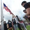 KRISTOPHER RADDER - BRATTLEBORO REFORMER<br /> A group of high school students raises the Black Lives Matter flag up the flagpole at Brattleboro Union High School on Friday, May 4, 2018.